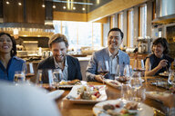 Happy business people dining at restaurant table - HEROF11019