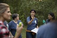 Woman preparing volunteers in park - HEROF11097