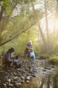 Women volunteering, cleaning up garbage in stream - HEROF11106