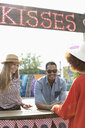 Young man and women at kissing booth - HEROF11163
