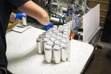 Worker canning beer in distillery - HEROF11259