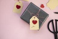 Valentine gift on pink background - MOMF00600