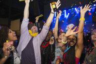 Friends enjoying New Year celebration in nightclub - HEROF12120