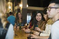 Friends talking and drinking at bar - HEROF12132