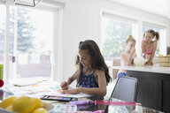 Girl coloring at dining table - HEROF12315