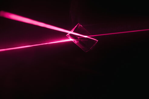 Creative abstract red laser prism refracting from cube - HEROF12714