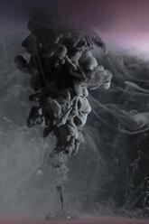 Creative, mysterious black liquid smoke rising - HEROF12726