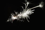 Creative, white sparks of inspiration on black background - HEROF12735