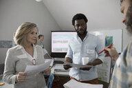 City planners and volunteers talking in office - HEROF12780