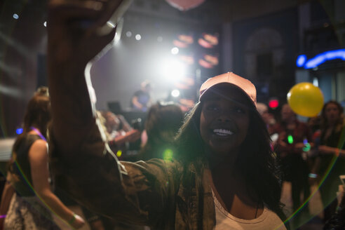 Confident young female millennial taking selfie at nightclub party - HEROF12786