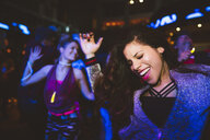 Carefree, enthusiastic young female millennial dancing, partying in nightclub - HEROF12789