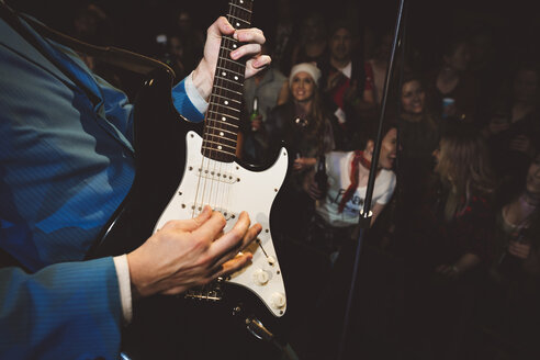 Close up rockabilly musician playing electric guitar at music concert - HEROF12801