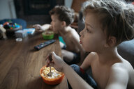 Curious bare chested brothers eating cereal and watching TV - HEROF12867