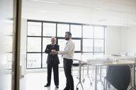 Businessmen talking in conference room - HEROF13122
