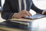 Close up businessman using digital tablet - HEROF13131
