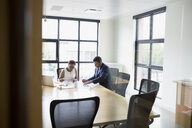 Architects working in conference room - HEROF13137