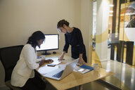 Businesswomen using digital tablet in conference room - HEROF13194