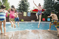 Boys and girls jumping into swimming pool - HEROF13260