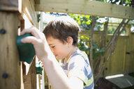 Boy playing on jungle gym - HEROF13278