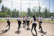 Middle school girl softball team running off field - HEROF13329