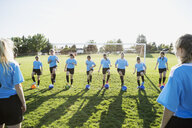 Middle school girl soccer team doing drills at practice on field - HEROF13368