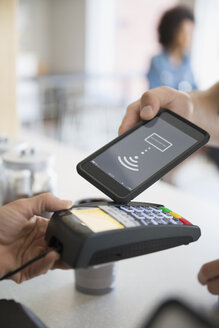 Man using cell phone contactless payment - HEROF13476