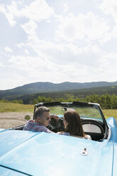 Mature couple in convertible at rural overlook - HEROF13482