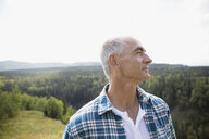 Mature man looking away on remote rural hillside - HEROF13533