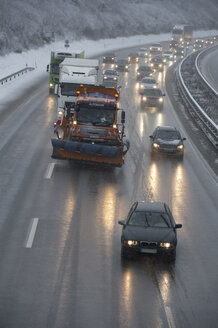 Germany, motorway in winter, icy road and traffic - CRF02828