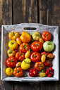 Wooden tray of various sorts of tomatoes - CSF29268