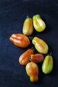 Eight San Marzano tomatoes on dark ground - CSF29283