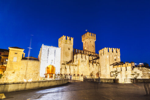 Italy, Lombardy, Sirmione, Scaligero Castle at dusk - FLMF00126