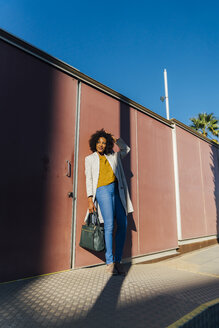 Beautiful woman standing in front of wall in the city - BOYF01306