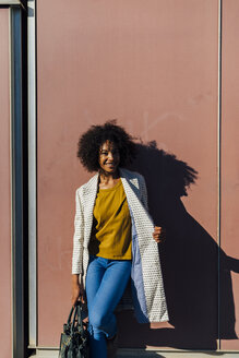 Beautiful woman standing in front of wall in the city - BOY01309