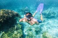 Australia, Queensland, Great Barrier Reef, Snorkeler near Lady Elliot Island - KIJF02254