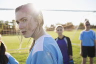 Serious middle school girl soccer player showing attitude on sunny field - HEROF13567