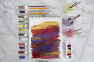 View from above watercolor paints, paintbrushes and painting - HEROF13612