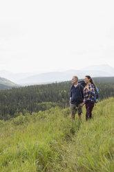 Senior couple hiking in remote rural field - HEROF13702