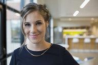 Portrait smiling businesswoman in office - HEROF13726