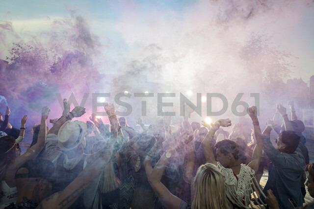 Powder over dancing crowd at summer music festival - HEROF13756