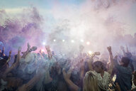 Powder over dancing crowd at summer music festival - HEROF13756