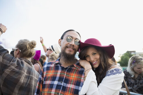 Portrait smiling young couple in crowd at summer music festival - HEROF13777