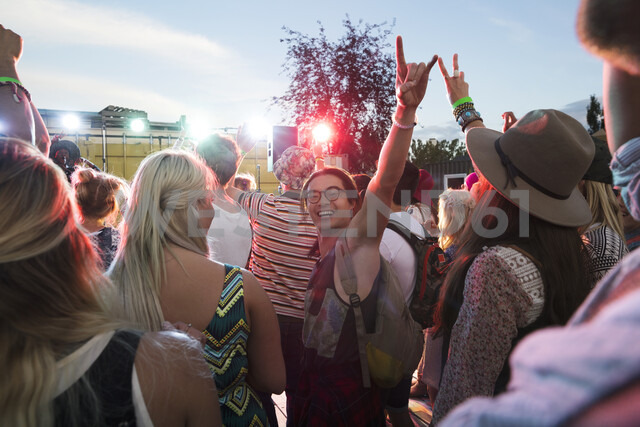 Portrait enthusiastic young man gesturing in crowd at summer music festival - HEROF13954