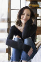 Portrait confident mature brunette woman wearing jeans and sweater - HEROF13972
