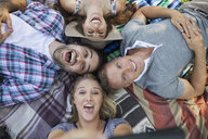 Overhead view playful couples taking selfie on blanket - HEROF14041