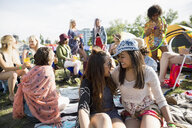 Young women enjoying summer music festival with friends at campsite - HEROF14062