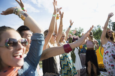 Young crowd cheering at summer music festival - HEROF14065