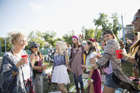 Young friends dancing and hanging out at summer music festival campsite - HEROF14125
