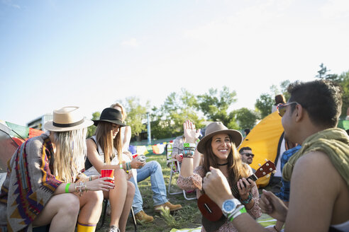 Young friends hanging out at summer music festival campsite - HEROF14134