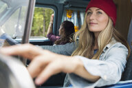 Woman driving camper van - HEROF14203